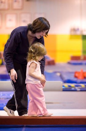 Mother Walking Daughter Down Balance Beam
